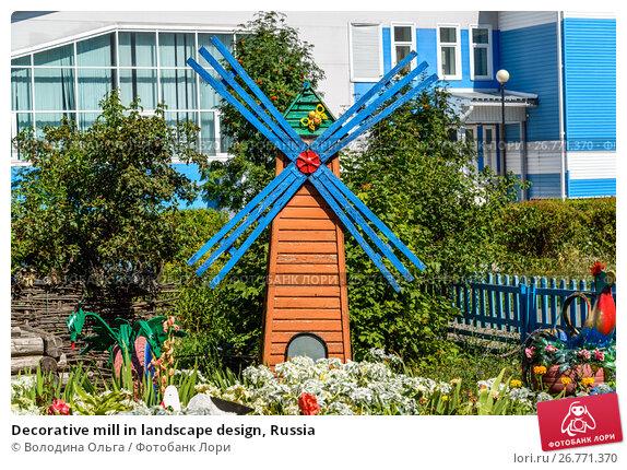 Купить «Decorative mill in landscape design, Russia», фото № 26771370, снято 14 августа 2017 г. (c) Володина Ольга / Фотобанк Лори