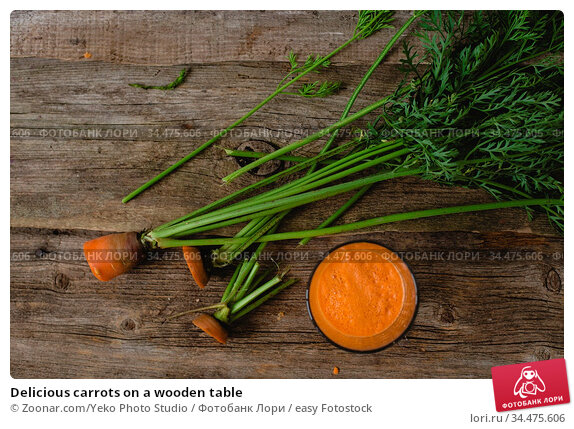 Delicious carrots on a wooden table. Стоковое фото, фотограф Zoonar.com/Yeko Photo Studio / easy Fotostock / Фотобанк Лори