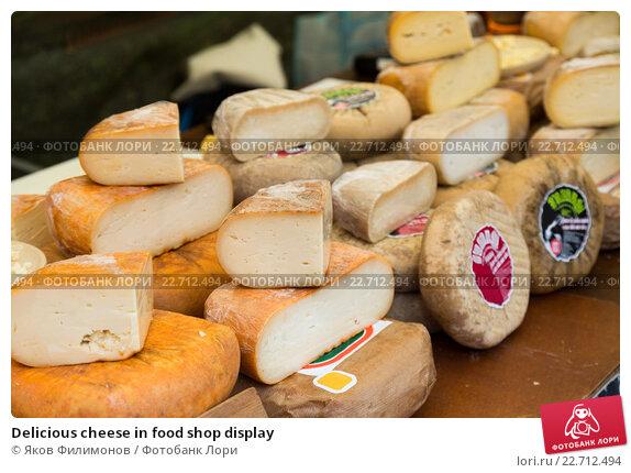 Купить «Delicious cheese in food shop display», фото № 22712494, снято 19 июня 2019 г. (c) Яков Филимонов / Фотобанк Лори