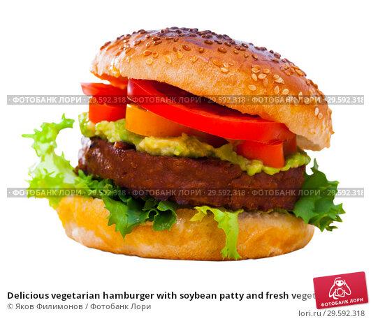 Купить «Delicious vegetarian hamburger with soybean patty and fresh vegetables», фото № 29592318, снято 20 апреля 2019 г. (c) Яков Филимонов / Фотобанк Лори