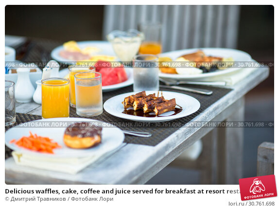 Купить «Delicious waffles, cake, coffee and juice served for breakfast at resort restaurant», фото № 30761698, снято 30 марта 2015 г. (c) Дмитрий Травников / Фотобанк Лори