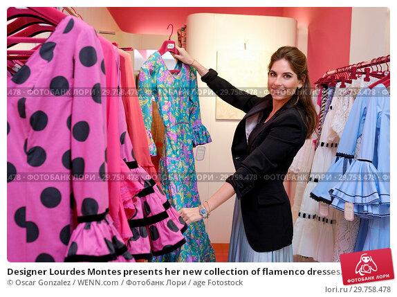 Купить «Designer Lourdes Montes presents her new collection of flamenco dresses Miabril Featuring: Lourdes Montes Where: Madrid, Spain When: 21 Feb 2018 Credit: Oscar Gonzalez/WENN.com», фото № 29758478, снято 21 февраля 2018 г. (c) age Fotostock / Фотобанк Лори