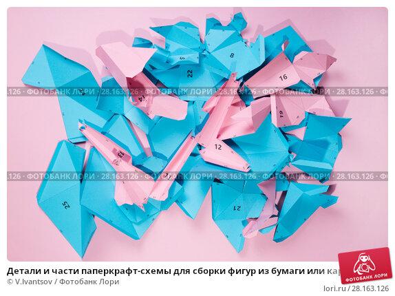 Купить «Детали и части паперкрафт-схемы для сборки фигур из бумаги или картона на розовом фоне», фото № 28163126, снято 9 марта 2018 г. (c) V.Ivantsov / Фотобанк Лори