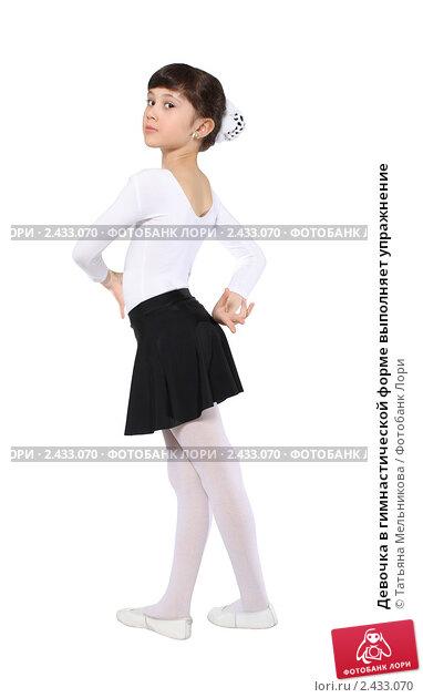 Купить «Девочка в гимнастической форме выполняет упражнение», фото № 2433070, снято 13 июня 2010 г. (c) Татьяна Мельникова / Фотобанк Лори