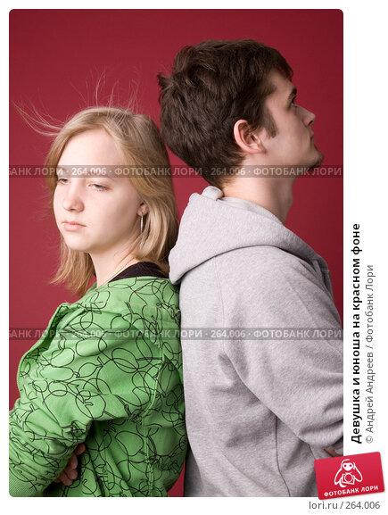 Девушка и юноша на красном фоне, фото № 264006, снято 26 апреля 2008 г. (c) Андрей Андреев / Фотобанк Лори
