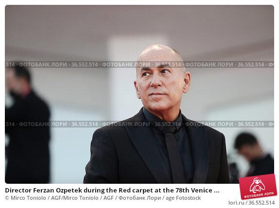 Director Ferzan Ozpetek during the Red carpet at the 78th Venice ... Редакционное фото, фотограф Mirco Toniolo / AGF/Mirco Toniolo / AGF / age Fotostock / Фотобанк Лори