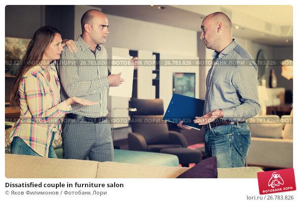 Купить «Dissatisfied couple in furniture salon», фото № 26783826, снято 16 мая 2017 г. (c) Яков Филимонов / Фотобанк Лори