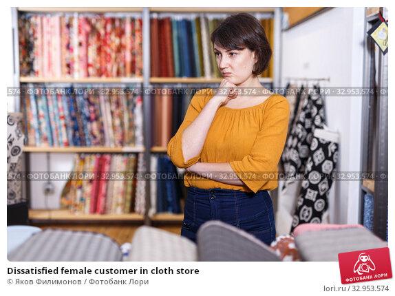 Dissatisfied female customer in cloth store. Стоковое фото, фотограф Яков Филимонов / Фотобанк Лори