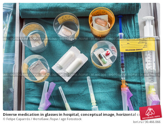 Diverse medication in glasses in hospital, conceptual image, horizontal composition. Стоковое фото, фотограф Felipe Caparrós / age Fotostock / Фотобанк Лори