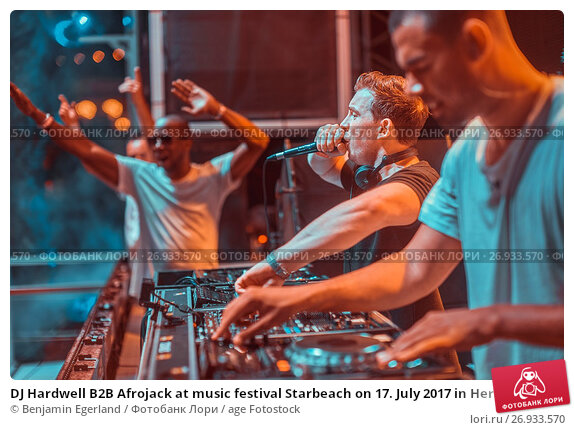 Купить «DJ Hardwell B2B Afrojack at music festival Starbeach on 17. July 2017 in Hersonissos, Crete, Greece - they played spontaneously B2B because the private...», фото № 26933570, снято 17 июля 2017 г. (c) age Fotostock / Фотобанк Лори