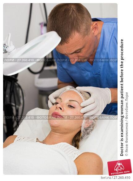 Купить «Doctor is examining woman patient before the procedure», фото № 27260410, снято 7 августа 2017 г. (c) Яков Филимонов / Фотобанк Лори