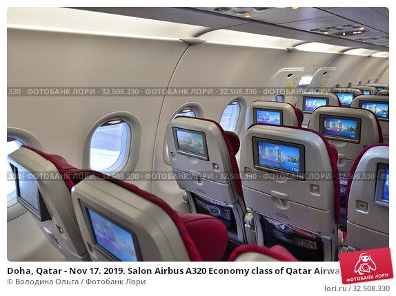 Купить «Doha, Qatar - Nov 17. 2019. Salon Airbus A320 Economy class of Qatar Airways», фото № 32508330, снято 17 ноября 2019 г. (c) Володина Ольга / Фотобанк Лори