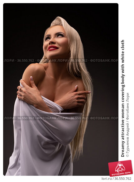 Dreamy attractive woman covering body with white cloth. Стоковое фото, фотограф Гурьянов Андрей / Фотобанк Лори