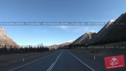 Купить «Driving along mountain asphalt road Chuysky Tract along Kurai Ridge on Altai betveen Kosh-Agach and Kurai intermountain hollows», видеоролик № 31526882, снято 6 июня 2019 г. (c) Serg Zastavkin / Фотобанк Лори