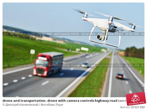 Купить «drone and transportation. drone with camera controls highway road conditions», фото № 29021850, снято 30 апреля 2018 г. (c) Дмитрий Калиновский / Фотобанк Лори