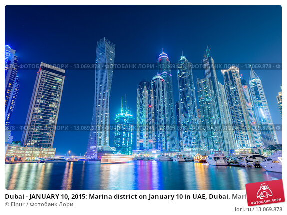 Купить «Dubai - JANUARY 10, 2015: Marina district on January 10 in UAE, Dubai. Marina district is popular residential area in Dubai», фото № 13069878, снято 10 января 2015 г. (c) Elnur / Фотобанк Лори