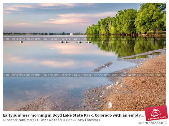 Early summer morning in Boyd Lake State Park, Colorado with an empty... Стоковое фото, фотограф Zoonar.com/Marek Uliasz / easy Fotostock / Фотобанк Лори
