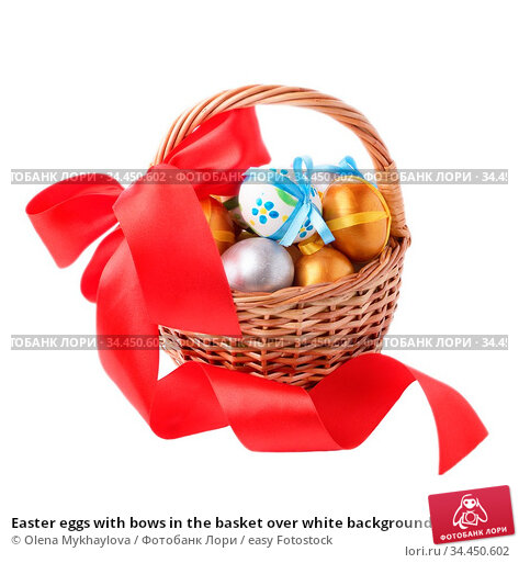 Easter eggs with bows in the basket over white background. Стоковое фото, фотограф Olena Mykhaylova / easy Fotostock / Фотобанк Лори