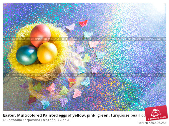 Купить «Easter. Multicolored Painted eggs of yellow, pink, green, turquoise pearl color in a basket on a holographic rainbow background with a copy space», фото № 30496234, снято 31 марта 2019 г. (c) Светлана Евграфова / Фотобанк Лори