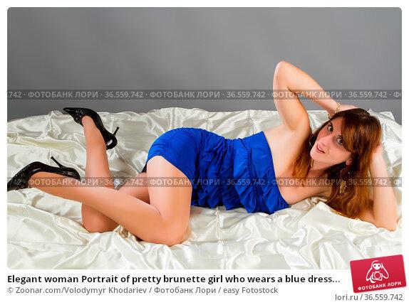 Elegant woman Portrait of pretty brunette girl who wears a blue dress... Стоковое фото, фотограф Zoonar.com/Volodymyr Khodariev / easy Fotostock / Фотобанк Лори