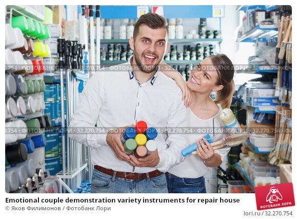 Купить «Emotional couple demonstration variety instruments for repair house», фото № 32270754, снято 17 мая 2018 г. (c) Яков Филимонов / Фотобанк Лори