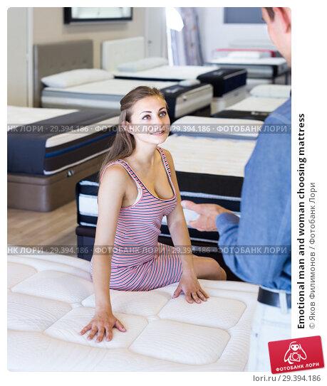 Купить «Emotional man and woman choosing mattress», фото № 29394186, снято 12 июня 2017 г. (c) Яков Филимонов / Фотобанк Лори