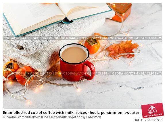 Купить «Enamelled red cup of coffee with milk, spices - book, persimmon, sweater, autumn maple on light background», фото № 34133918, снято 3 июля 2020 г. (c) easy Fotostock / Фотобанк Лори