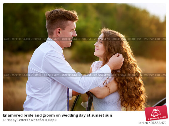 Enamored bride and groom on wedding day at sunset sun, фото № 26552470, снято 23 августа 2017 г. (c) Галина Тимонько / Фотобанк Лори