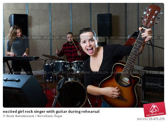 Купить «excited girl rock singer with guitar during rehearsal», фото № 29475270, снято 26 октября 2018 г. (c) Яков Филимонов / Фотобанк Лори
