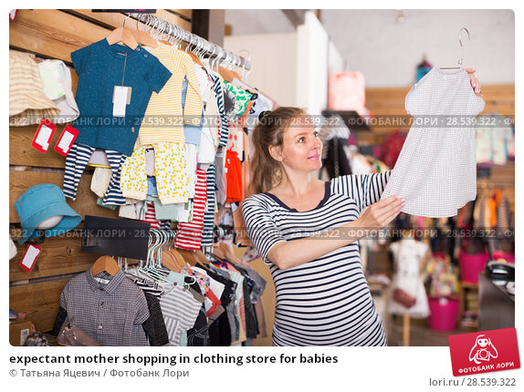 Купить «expectant mother shopping in clothing store for babies», фото № 28539322, снято 6 апреля 2017 г. (c) Татьяна Яцевич / Фотобанк Лори