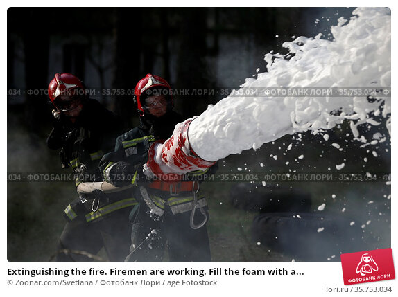 Extinguishing the fire. Firemen are working. Fill the foam with a... Стоковое фото, фотограф Zoonar.com/Svetlana / age Fotostock / Фотобанк Лори