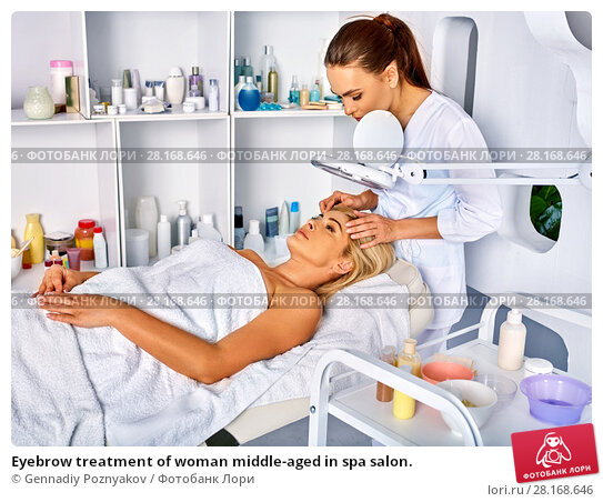 Купить «Eyebrow treatment of woman middle-aged in spa salon.», фото № 28168646, снято 6 октября 2015 г. (c) Gennadiy Poznyakov / Фотобанк Лори
