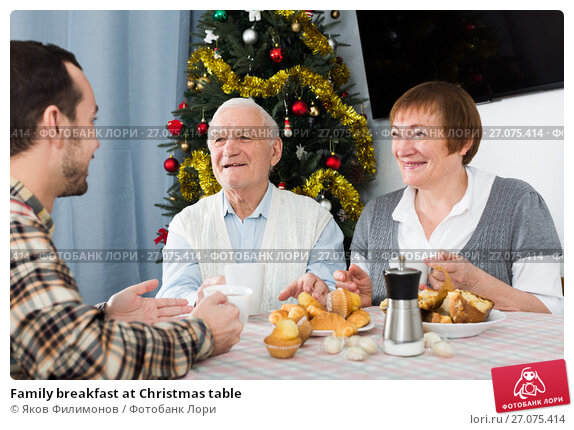 Family breakfast at Christmas table, фото № 27075414, снято 18 октября 2017 г. (c) Яков Филимонов / Фотобанк Лори