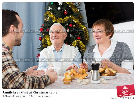 Купить «Family breakfast at Christmas table», фото № 27075414, снято 13 декабря 2017 г. (c) Яков Филимонов / Фотобанк Лори