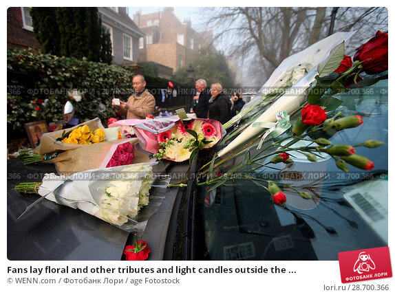 Купить «Fans lay floral and other tributes and light candles outside the home of singer George Michael in memory of the popular performer. His Range Rover has...», фото № 28700366, снято 28 декабря 2016 г. (c) age Fotostock / Фотобанк Лори