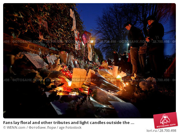 Купить «Fans lay floral and other tributes and light candles outside the home of singer George Michael in memory of the popular performer. His Range Rover has...», фото № 28700498, снято 28 декабря 2016 г. (c) age Fotostock / Фотобанк Лори