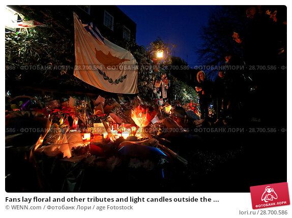 Купить «Fans lay floral and other tributes and light candles outside the home of singer George Michael in memory of the popular performer. His Range Rover has...», фото № 28700586, снято 28 декабря 2016 г. (c) age Fotostock / Фотобанк Лори