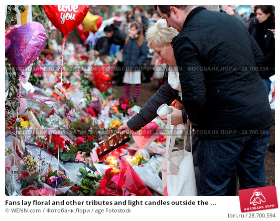 Купить «Fans lay floral and other tributes and light candles outside the home of singer George Michael in memory of the popular performer. His Range Rover has...», фото № 28700594, снято 28 декабря 2016 г. (c) age Fotostock / Фотобанк Лори