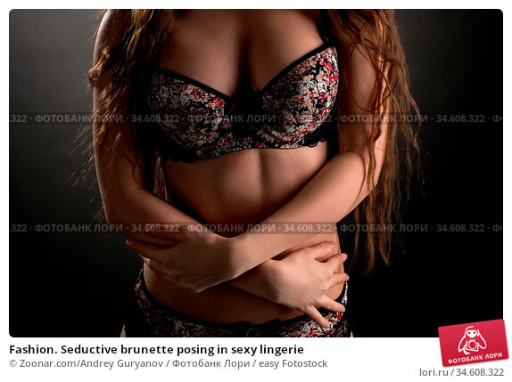 Fashion. Seductive brunette posing in sexy lingerie. Стоковое фото, фотограф Zoonar.com/Andrey Guryanov / easy Fotostock / Фотобанк Лори