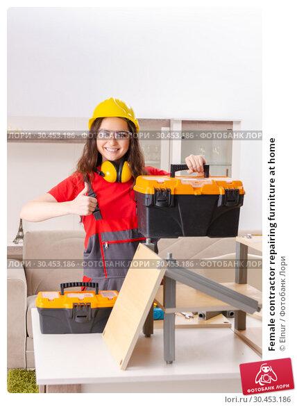 Female contractor repairing furniture at home. Стоковое фото, фотограф Elnur / Фотобанк Лори