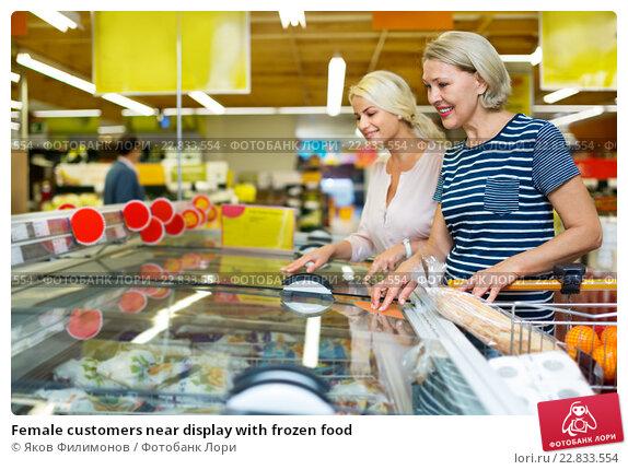 Купить «Female customers near display with frozen food», фото № 22833554, снято 16 февраля 2019 г. (c) Яков Филимонов / Фотобанк Лори