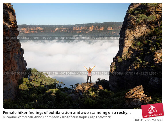 Female hiker feelings of exhilaration and awe stainding on a rocky... Стоковое фото, фотограф Zoonar.com/Leah-Anne Thompson / age Fotostock / Фотобанк Лори