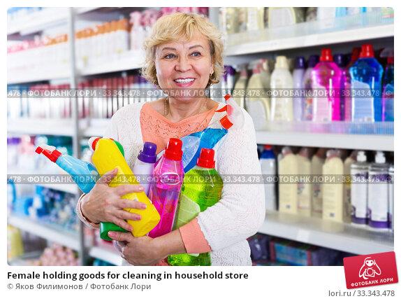 Купить «Female holding goods for cleaning in household store», фото № 33343478, снято 20 декабря 2017 г. (c) Яков Филимонов / Фотобанк Лори