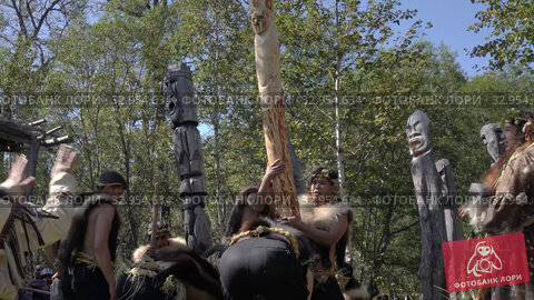 Female in traditional clothing aboriginal conducts ritual - dig wooden idol in ground. Itelmens national ritual festival of thanksgiving nature Alhalalalay. Kamchatka Peninsula (2019 год). Редакционное видео, видеограф А. А. Пирагис / Фотобанк Лори