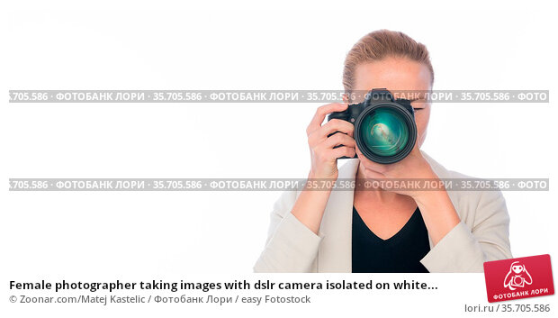 Female photographer taking images with dslr camera isolated on white... Стоковое фото, фотограф Zoonar.com/Matej Kastelic / easy Fotostock / Фотобанк Лори