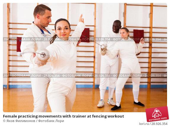 Купить «Female practicing movements with trainer at fencing workout», фото № 28926354, снято 11 июля 2018 г. (c) Яков Филимонов / Фотобанк Лори