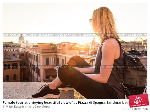 Купить «Female tourist enjoying beautiful view of at Piazza di Spagna, landmark square with Spanish steps in Rome, Italy at sunset.», фото № 28926590, снято 22 августа 2018 г. (c) Matej Kastelic / Фотобанк Лори