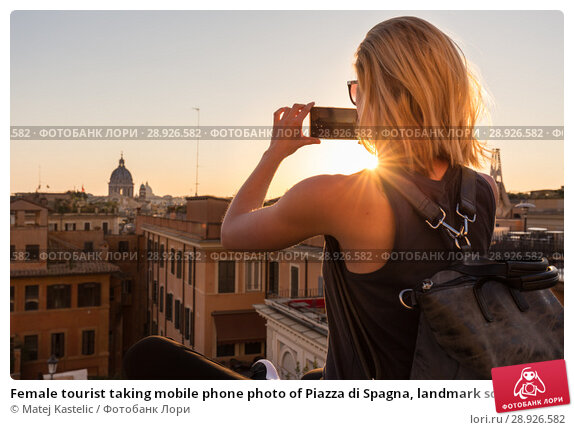 Купить «Female tourist taking mobile phone photo of Piazza di Spagna, landmark square with Spanish steps in Rome, Italy at sunset.», фото № 28926582, снято 21 августа 2018 г. (c) Matej Kastelic / Фотобанк Лори