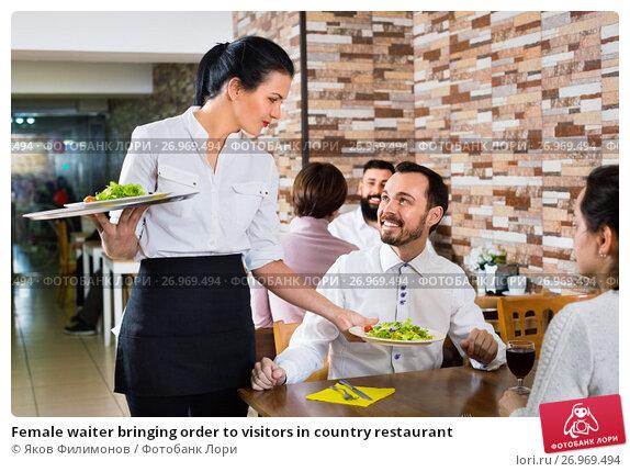 Купить «Female waiter bringing order to visitors in country restaurant», фото № 26969494, снято 17 января 2017 г. (c) Яков Филимонов / Фотобанк Лори