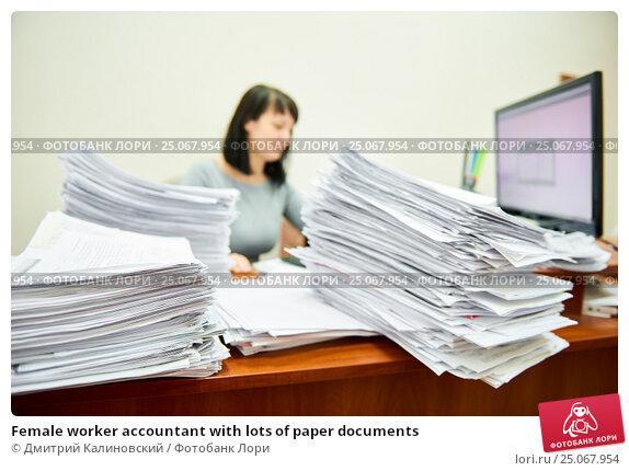 Купить «Female worker accountant with lots of paper documents», фото № 25067954, снято 27 января 2017 г. (c) Дмитрий Калиновский / Фотобанк Лори